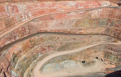 Deep mine hole in rock strata Stock Photo
