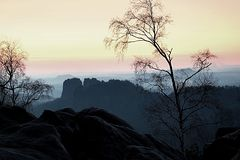 Deep misty valley within sunset. Foggy and misty moment on sandstone view poin Royalty Free Stock Photo