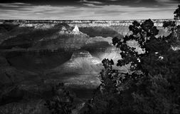 Deep Monochromatic Grand Canyon Sunset. Monochrome of the Grand Canyon at sunset, deep shadows, right textures, dramatic sky Royalty Free Stock Image