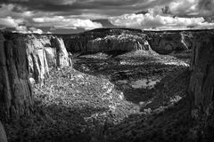 Deep Monochromatic Navajo Canyon Sunset. Monochrome of Navajo Canyon, Arizona, at sunset, deep shadows, right textures, dramatic sky Royalty Free Stock Photography