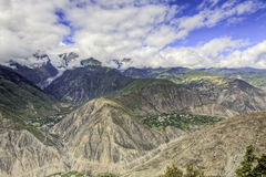 Deep Mountain Valleys. In the far north of Yunnan province, near the border of Tibet, stand Mei Li Snow Mountain with it's deep valleys and small villages at its Stock Photo