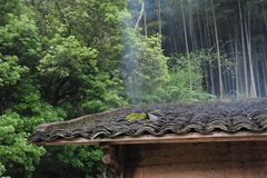 A black tile roof-Deep mountain hut. Deep in the mountains, a small building, covered with black tiles Stock Images