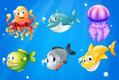A deep ocean with smiling creatures Royalty Free Stock Images