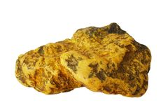 Deep orange-yellow colored  orpiment mineral isolated Royalty Free Stock Images