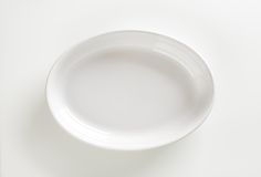 Deep oval porcelain dish Stock Image