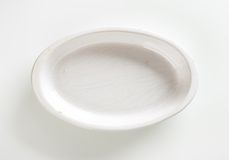Deep oval porcelain dish Stock Image
