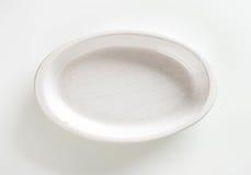 Deep oval porcelain dish. Empty deep oval porcelain baking dish Stock Image