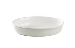 Deep oval porcelain dish Royalty Free Stock Image