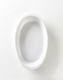 Deep oval porcelain roasting dish Royalty Free Stock Photography