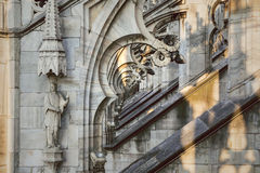 Deep perspective through the gothic arches of the cathedral Duomo di Milano. Stock Photos