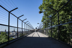 Deep perspective of a walkway with high fences royalty free stock photography