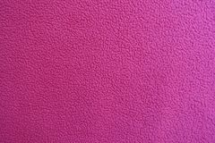 Deep pink fleece fabric from above. Deep pink polar fleece fabric from above Stock Photography