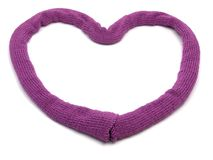 Deep pink knitting scarf. Arranged as heart on white royalty free stock images