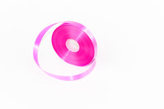 Deep Pink Roll Ribbon isolated. Background stock images