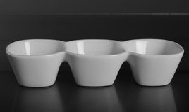 Deep porcelain bowl with three compartments. Front view. Deep porcelain bowl with three compartments Stock Photo