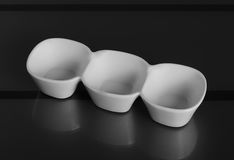Deep porcelain bowl with three compartments. Top view. Deep porcelain bowl with three compartments Royalty Free Stock Photos