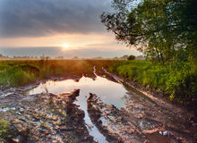 Deep puddle on a road Stock Photo