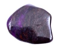Deep purple Manganese with sugilite tumbled stone from South Africa. Isolated on white background Stock Image