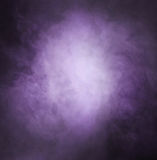Deep purple smoke background with light. Deep purple smoke background with bright light in the center Royalty Free Stock Photography