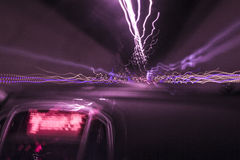 Deep purple speed tunnel. Car goes fast in the tunnel Royalty Free Stock Images