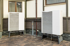 Deep radiators, heat pump, mounted near the house Royalty Free Stock Photo
