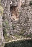 Deep rectangle hole cut into the rock Stock Images