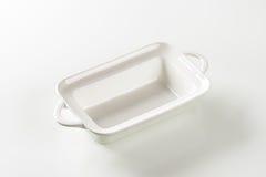 Deep rectangular white ceramic dish Stock Photos