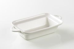 Deep rectangular white ceramic dish Royalty Free Stock Photos