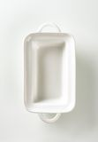 Deep rectangular white ceramic dish Stock Photo