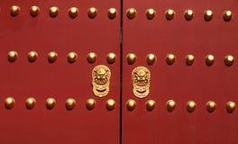 Deep Red Chinese Doors. Dark Red Doors with handles Stock Photo