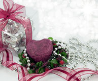 Deep red heart with gift,ribbon,and silver beads. Stock Photo