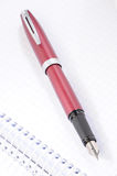 Deep red ink pen Stock Photos