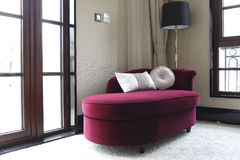 Deep red leisure sofa in the bedroom Royalty Free Stock Images