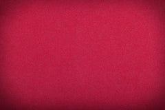 Deep red paper texture. Deep red rough paper texture,dark vignette Stock Image