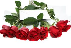 Deep red roses with a note. This roses bouquet is ideal for some celebration date Royalty Free Stock Photo
