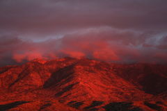 Deep Red sunset in the  Santa Catalina Pusch Ridge mountains in Tucson, Arizona Stock Photos