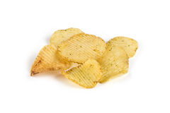 Deep ridged potato chips. Heap of deep ridged potato chips. Crisps. Isolated on white background Stock Image