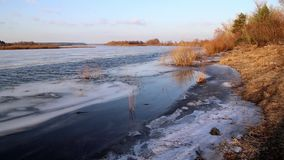 Deep river on the eve of ice drift in the spring in March. Deep river on the eve of ice drift in the spring in March, against the backdrop of a sunny sky stock video footage
