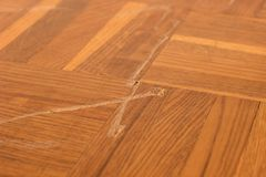 Deep scratches on old wooden parquet. Royalty Free Stock Image