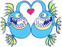 Deep sea fishes falling in love Stock Photos
