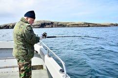 Deep sea fishing. Senior man fishing on boat, Ireland Royalty Free Stock Photo