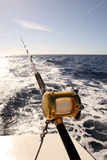 Deep sea fishing. Fishing rod with reel trolling on a boat Royalty Free Stock Photos