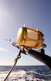 Deep sea fishing. Fishing rod with reel trolling on a boat Stock Photography