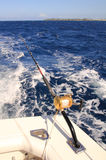 Deep sea fishing. Fishing rod with reel trolling on a boat Stock Photos