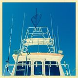 Deep sea fishing boat. Front of a modern deep sea fishing boat with aerials and antennae Stock Photo