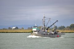 Deep Sea Fishing Boat Returns to Richmond, Canada. The Cape Stephen,  a deep sea fishing vessel, returns home to Richmond, British Columbia, Canada on September Royalty Free Stock Photos