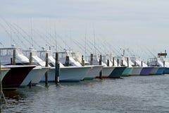 Deep sea fishing boats. Row of deep sea fishing boat in a marina Royalty Free Stock Image