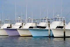 Deep sea fishing boats. Row of nice deep sea fishing boats in a marina Stock Photos