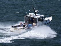 Deep Sea Fishing Charter. Chartering a private Deep Sea Fishing boat is a popular and expensive way for tourist to enjoy a rewarding day on the water Stock Photos