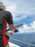 Deep sea fishing. A fisherman in a boat fight against a fish. Madagascar deep sea fishing Stock Images
